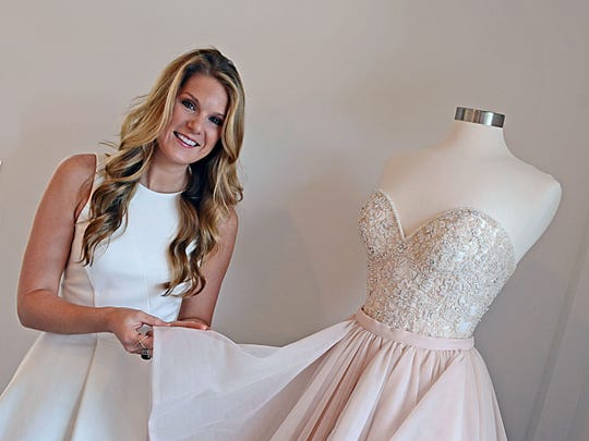 Kristin Panetta, owner of Elle James Bridal, found her true calling to be a bridal consultant while working as a party planner. Panetta poses next to a Martina Liana dress with lace beaded Cayla corset  and deep sweetheart neckline in a blush-hued stone color.