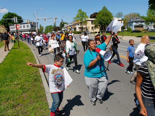 Peace walk participants cheer and chant during the event.