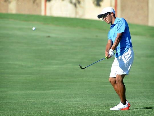Robert Garcia Jr. hits an approach shot during the
