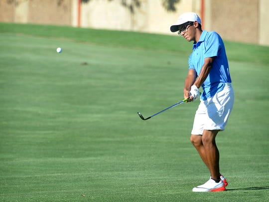 Robert Garcia Jr. hits an approach shot during the final round of the Texas-Oklahoma Junior Golf Championship Wednesday at the Wichita Falls Country Club.