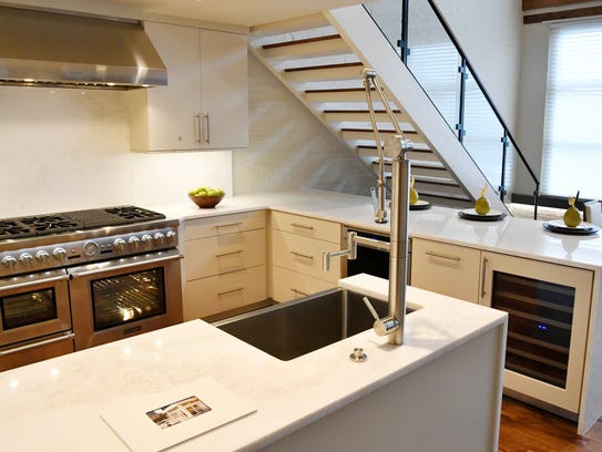 The kitchen inside a  3-bedroom rooftop home at 207