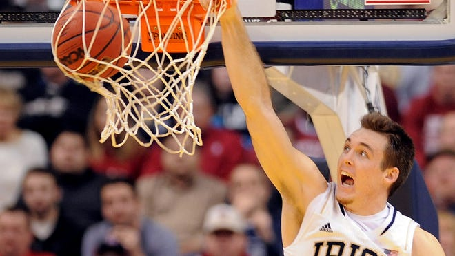 Notre Dame's Pat Connaughton dunks the ball against Indiana during the second half, Saturday, December 14, 2013, at Bankers Life Fieldhouse.