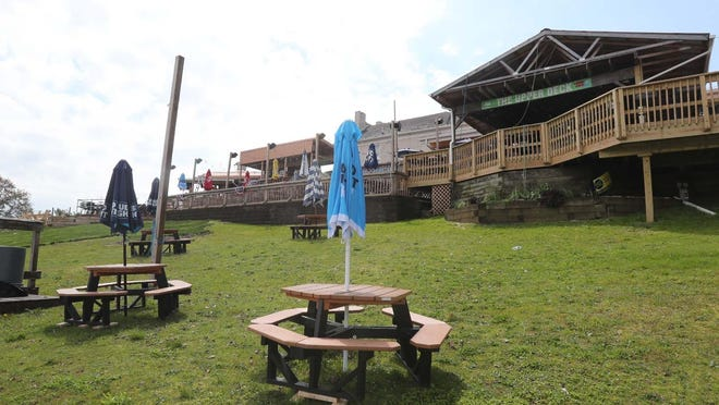 Picnic benches are spaced apart on the lawn at the Upper Deck Bar & Grill on Friday, May 15, 2020, in New Franklin, Ohio.