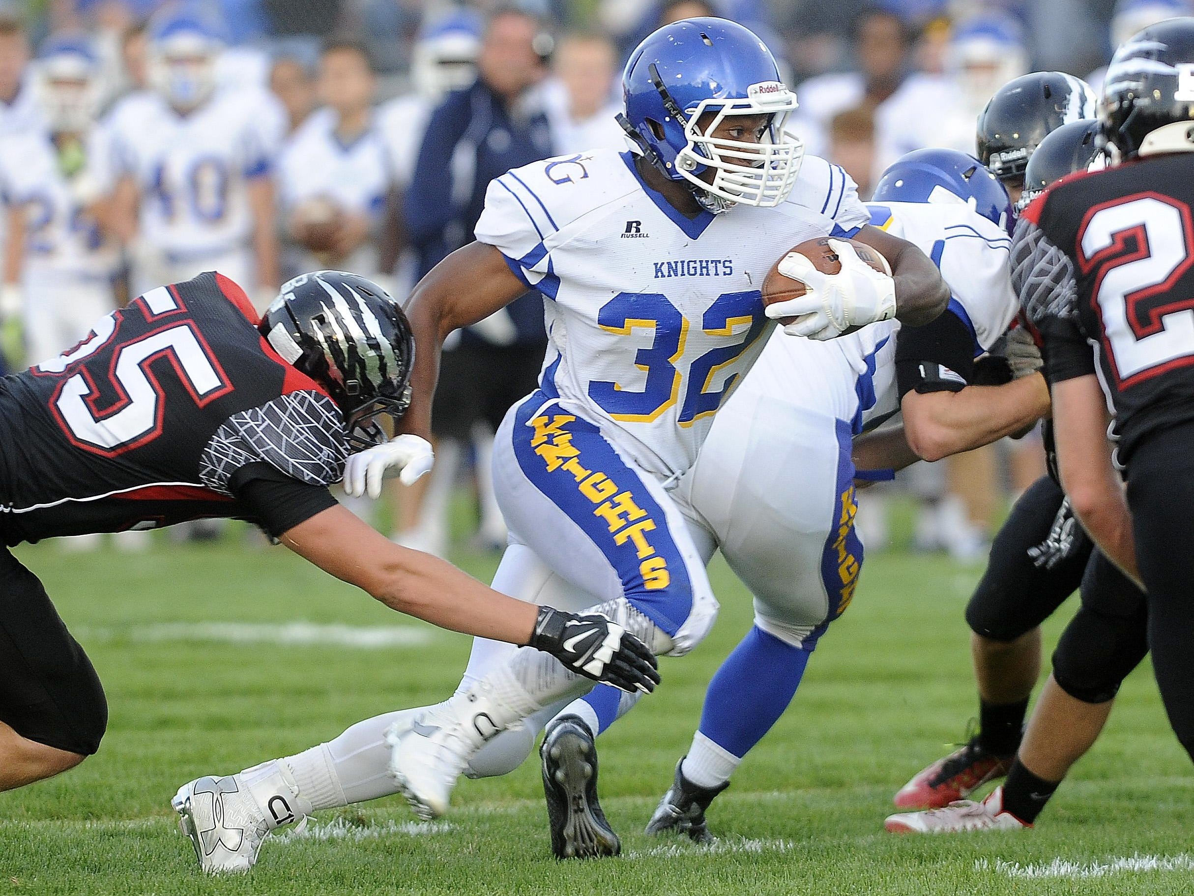 Dodi Makwinja runs against Brandon Valley in September. Makwinja rushed 15 times for 128 yards and two scores in the Knights' 42-10 win over Watertown last Friday.
