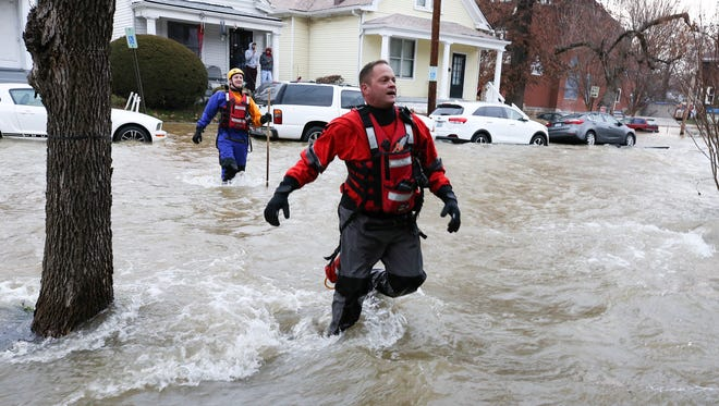 Rescue crews walked the streets around Shelby Park to make sure residents were okay after water flooded the streets due to a 48-inch water main break.