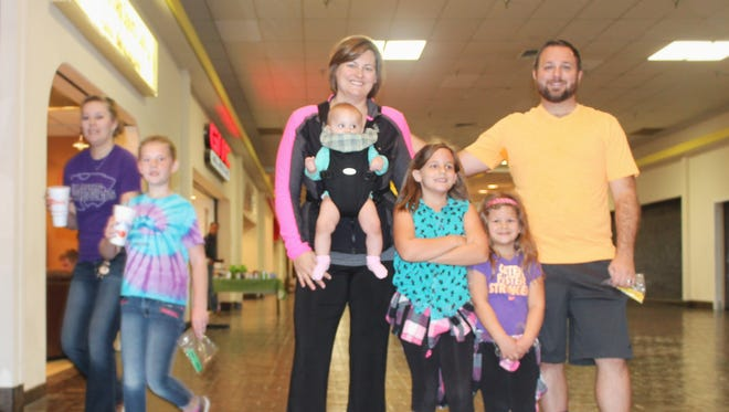 The Gigler family walks the White Sands Mall together during the inaugural Walk For Your Heart event.