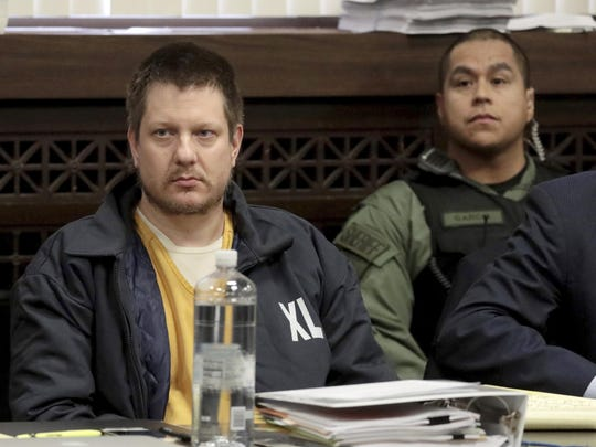Former Chicago police Officer Jason Van Dyke, left, appears for a hearing at the Leighton Criminal Court Building, in Chicago.
