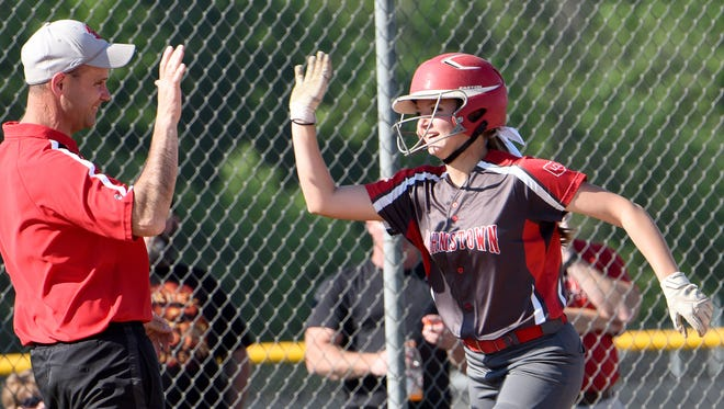 Third base coach Ed Schaffer high fives Haylee Frost after Frost hit a homer in the Johnnies won Division III district semifinal game on Tuesday, May 16, 2017, at Pickerington North High School. The Johnnies won 5-0.