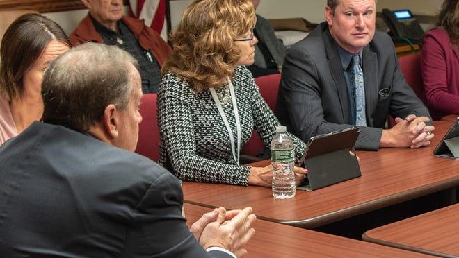 In a Nov. 4, 2019 file photo, Steuben County Legislator Steven Maio, D-Corning, right, listens as District Attorney Brooks Baker speaks during a meeting of the Legislature's Public Safety and Corrections Committee.