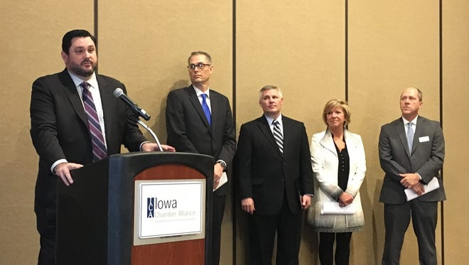 Iowa Chamber Alliance Executive Director John Stineman unveils the group's legislative priorities at a press conference Wednesday.