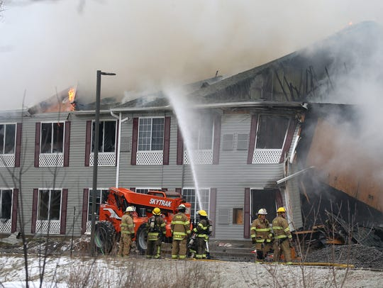 A former hotel was destroyed by fire along West Henrietta