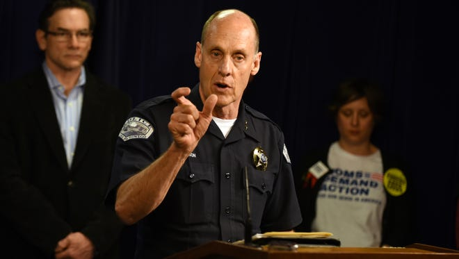 Lake Oswego Police Chief Don Johnson speaks during a news conference following a hearing on a bill that would expand background checks for private gun sales at the state Capitol.