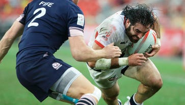 Nate Ebner, right, of the United States tries to get past Dougie Fife of Scotland  during the 2016 Singapore Sevens Bowl Final between United States and Scotland in April.