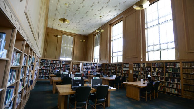 A quiet summer afternoon at the reference room at the Oregon State Library in Salem on Monday. Officials plan to end public research services.