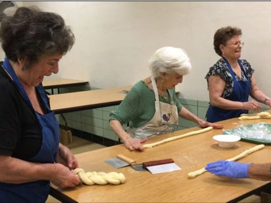 Ann Brown and volunteers made braided bread for the St. Peter's Bake Sale which will be held Tuesday and Wednesday.