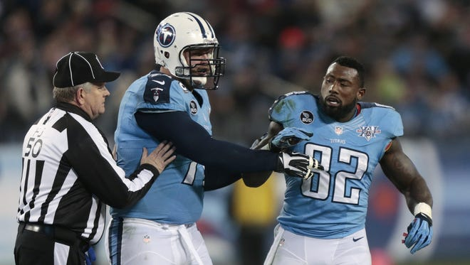 Titans tight end Delanie Walker (82) expects a physical matchup against the Colts after having his helmet ripped off by linebacker Erik Walden (not shown) in the teams? Nov. 14 game.  wade payne / AP Tennessee Titans tight end Delanie Walker (82) is restrained by tackle Michael Roos, center, and field judge Mike Weir (50) during an altercation in the second quarter of an NFL football game between the Titans and the Indianapolis Colts on Thursday, Nov. 14, 2013, in Nashville, Tenn. (AP Photo/Wade Payne)