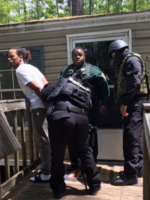 GCSO SWAT team apprehends federal fugitive Addrian McMillan.