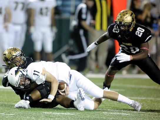 Abilene High linebacker Devin Romero (50) sacks Keller