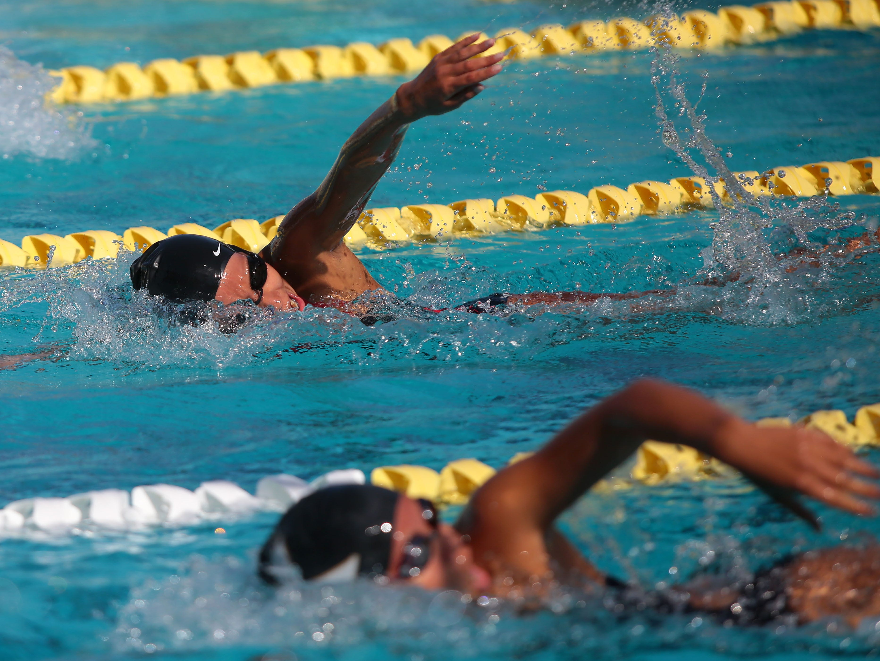 Palm Springs' Kaylin Ackers (background) swims the 100 freestyle as Palm Springs hosts Xavier in a high school swim meet on Monday, April 25, 2016, at the Palm Springs Swim Center.