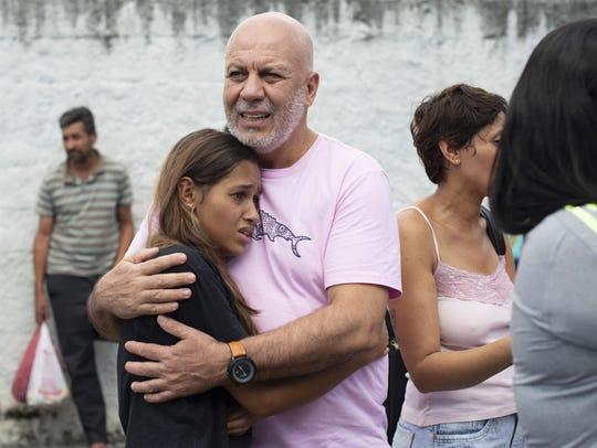The scene outside the Raul Brasil State School in Suzano,
