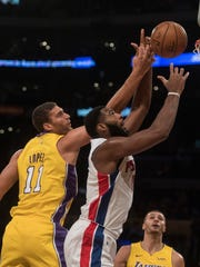 Pistons center Andre Drummond, right, goes up for a
