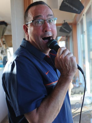 Harrison announcer Sam Newton informs and entertains the fans during a recent home football game.