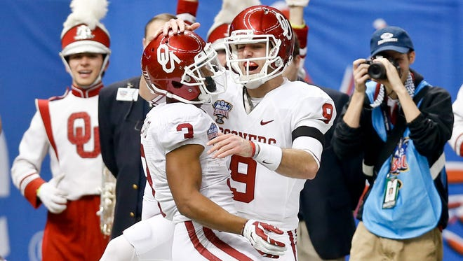 Oklahoma Sooners quarterback Trevor Knight (9) celebrates a touchdown pass with wide receiver Sterling Shepard (3) during the second quarter of a game against the Alabama Crimson Tide at the Mercedes-Benz Superdome.