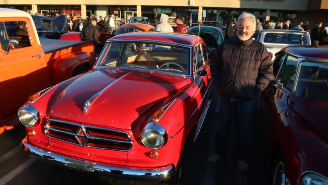 Nick Ilyadis poses with his 1961 Borgward Isabella at the Donut Derelicts car show  in Huntington Beach, Calif.