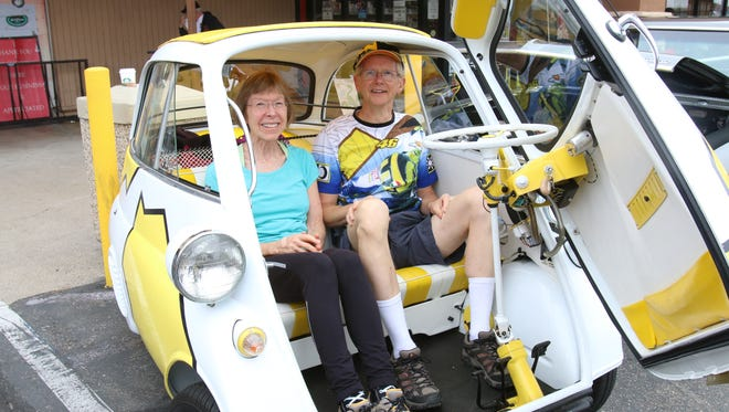 Marvin and Debbie Josphson sit in their 1957 BMW Isetta at the Donut Derelicts car show in Huntington Beach,Calif.
