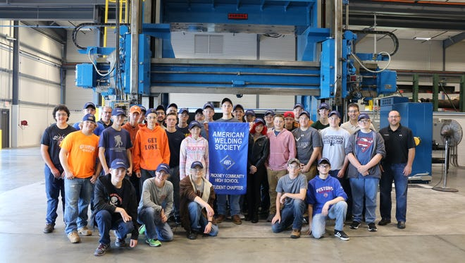 Pinckney Community High School students in the manufacturing and welding program.