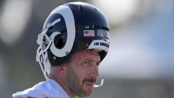 Los Angeles Rams linebacker Connor Barwin wears a blue and white helmet backwards during training camp at UC Irvine.