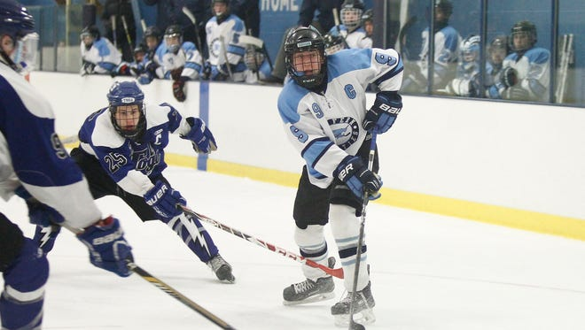 Suffern's Tim Patwell (9) passes the puck during a power-play against Saratoga at Sport-O-Rama on Monsey on Friday, Jan. 15, 2016.