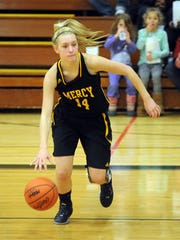 Sophomore point guard Jenna Schluter works against