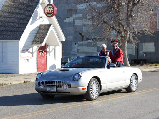 Dottie and Bill ride in the Homecoming parade in Sunburst 55 years after being Homecoming queen and king.
