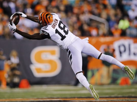 Bengals receiver A.J. Green stretches for a reception againist Miami.