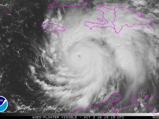 A satellite image shows Hurricane Matthew spinning