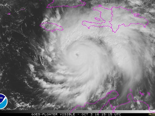 A satellite image shows Hurricane Matthew spinning