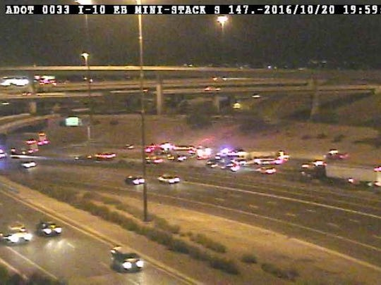 An Arizona Department of Transportation traffic camera shows the emergency response to a serious crash on Interstate 10 in Phoenix on Oct. 20, 2016.