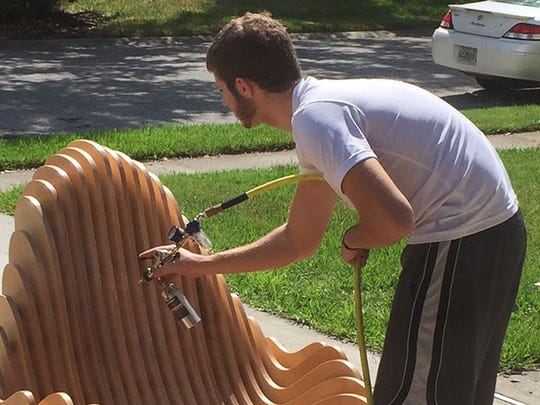 FSU graduate Nick O'Donnell works on a piece of furniture