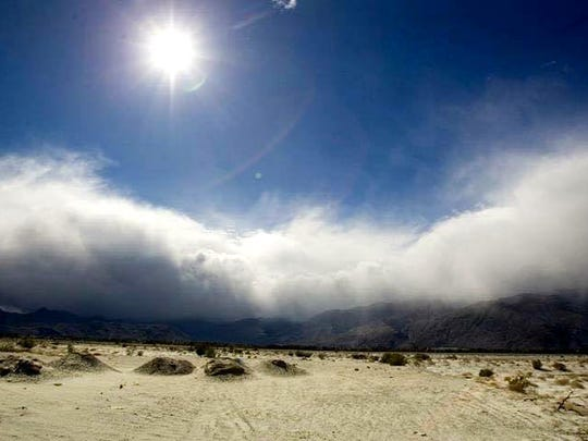 Clouds rolling over the mountains in the Palm Springs area desert.