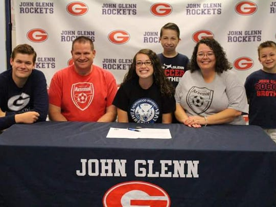 Westland John Glenn grad Kaitlyn Balko celebrate with family members after signing her national letter of intent to play women's soccer at Northwood University. The Balkos at the June 9 signing included (from left) brother Brendan, father Ryan, Kaitlyn, brother Landon, mother Tosya and brother Evan.
