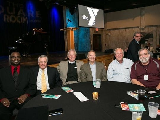 At the Power of the Y luncheon at the Square Room are Michael Rodgers, John Harber, Jerry Askew, Rick Blackburn, Mike Edwards and Larry Whittlesey.
