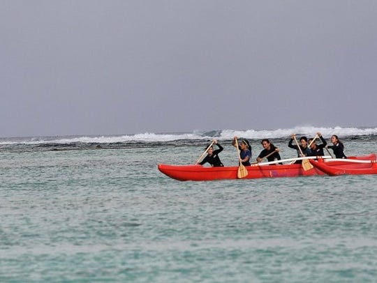 Academy of Our Lady of Guam paddlers going the distance