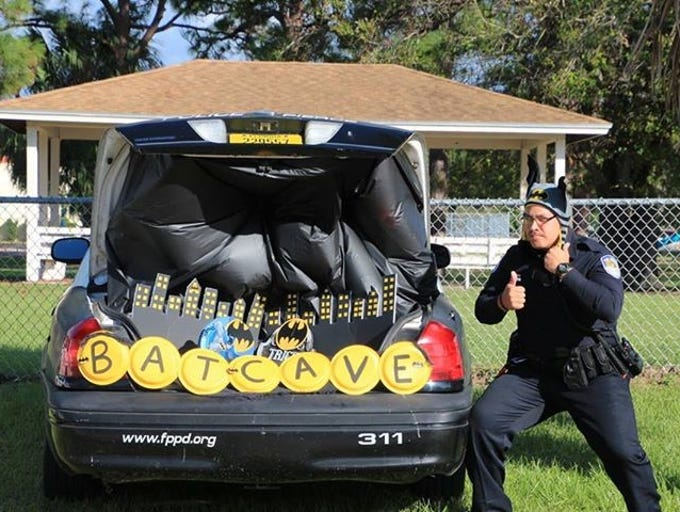 Fort Pierce officer poses in front of his Bat Cave