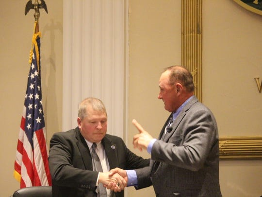 Anderson County Council members Ray Graham, left, and Tommy Dunn shake hands at Tuesday night's meeting. Dunn will act as the council's chairman and Graham will serve as vice chairman for 2018.