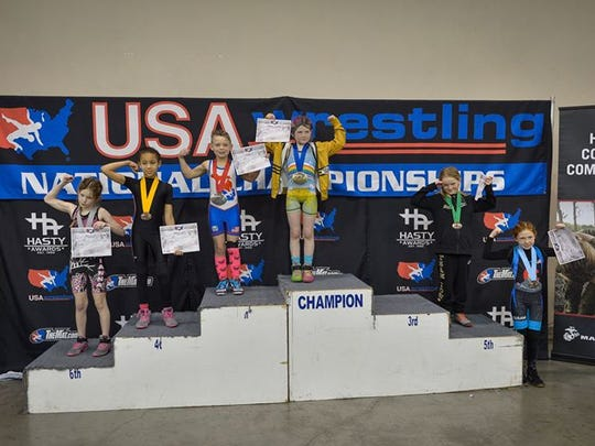 Cadence Butts won 2nd place All American at the UMSC USAW Girls Nationals in Oklahoma City, Oklahoma.