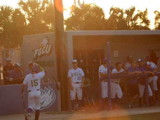 Gage Morey (15) walks back to the dug out after striking