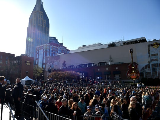 Titans fans arrive before the Titans uniform reveal in downtown Nashville on Wednesday, April 4, 2018.
