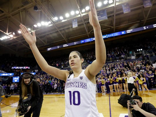 Washington's Kelsey Plum waves to fans after the team's NCAA college basketball game against Utah on Saturday, Feb. 25, 2017, in Seattle. Plum set the all-time career NCAA scoring record, finishing the game with 3,397 points. Washington won 84-77. (AP Photo/Elaine Thompson)