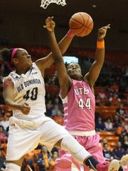 UTEP's Tamara Seda (44) gets the ball deflected, drawing a foul from Old Dominion's Destinee Young, while putting up a shot in the second half Thursday night in the Don Haskins Center. Seda sank one of two free throws late in the game to help the Miners win, 70-64.